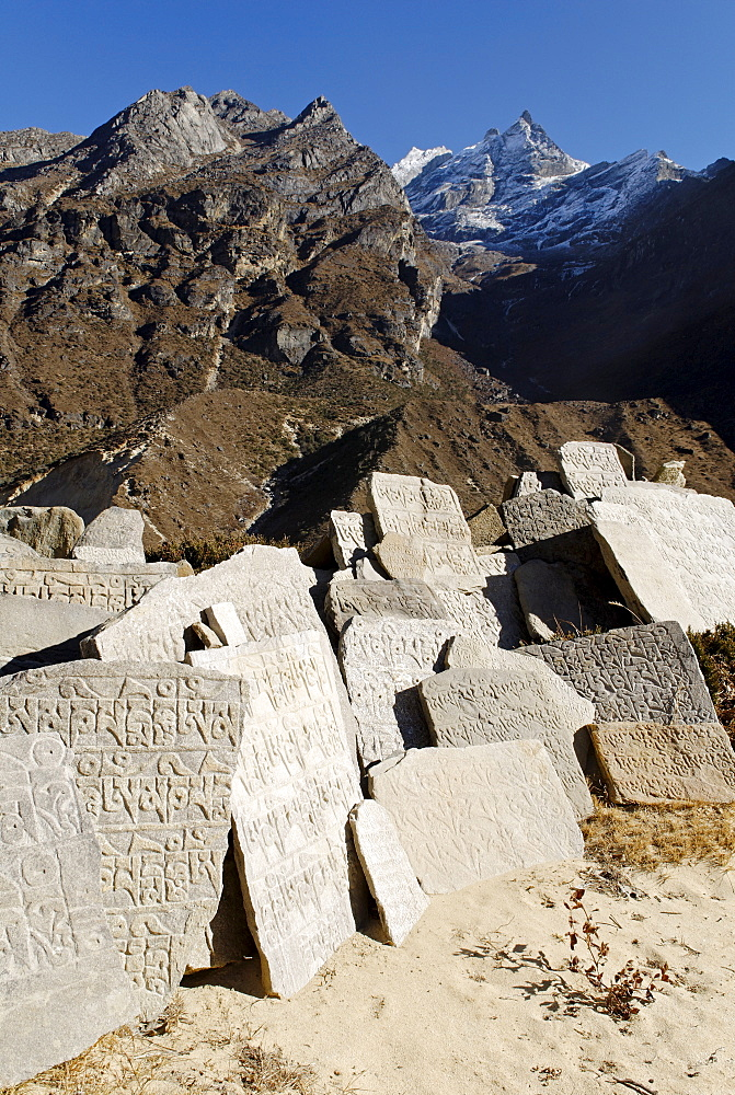 Mani wall at Thame Sherpa village with Khumbi Yu La (Khumbila, 5761), Sagarmatha National Park, Khumbu Himal, Nepal