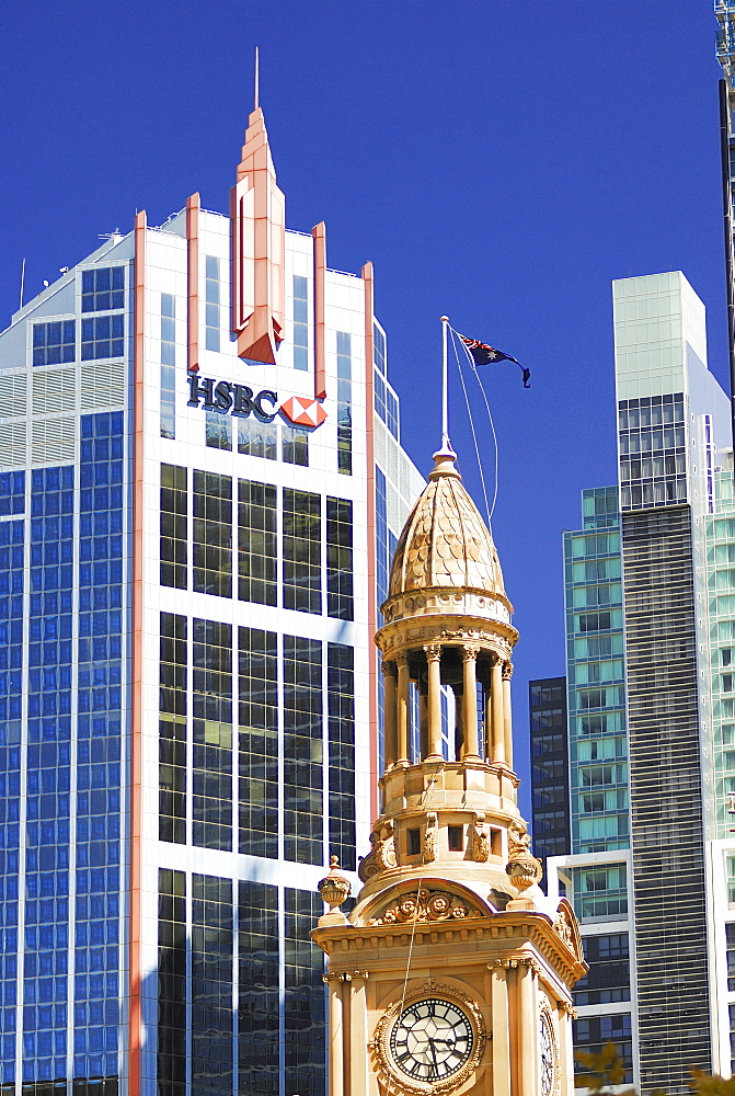 Town hall clock tower in front of the HSBC skyscraper, Sydney, New South Wales, Australia