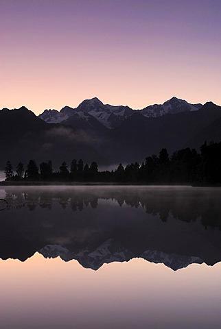 Mount Tasman and Mount Cook, Aoraki, Mount Cook National Park reflected in Lake Matheson, Westland National Park, Southern Alps, west coast, South Island, New Zealand