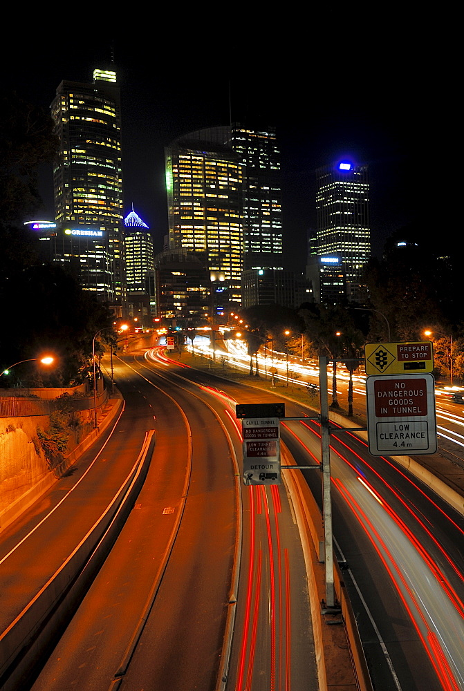 Light trails left by cars on an expressway, skyscrapers, Sydney, New South Wales, Australia