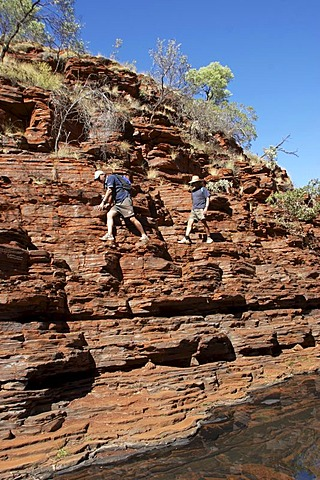 Hiking and rock climbing Hancock Gorge Karijini National Park Pilbara region western australia WA