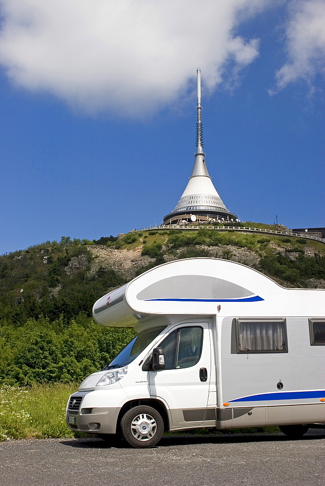 Motorhome in front of Jested Mountain, 1012 m, television tower and Hotel built by the architect Hubacek, Liberec, Czech Republic