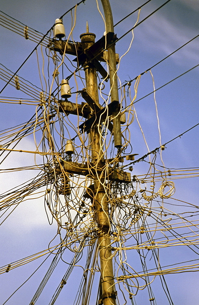 Tangled electrical and telephone cables in India, Asia