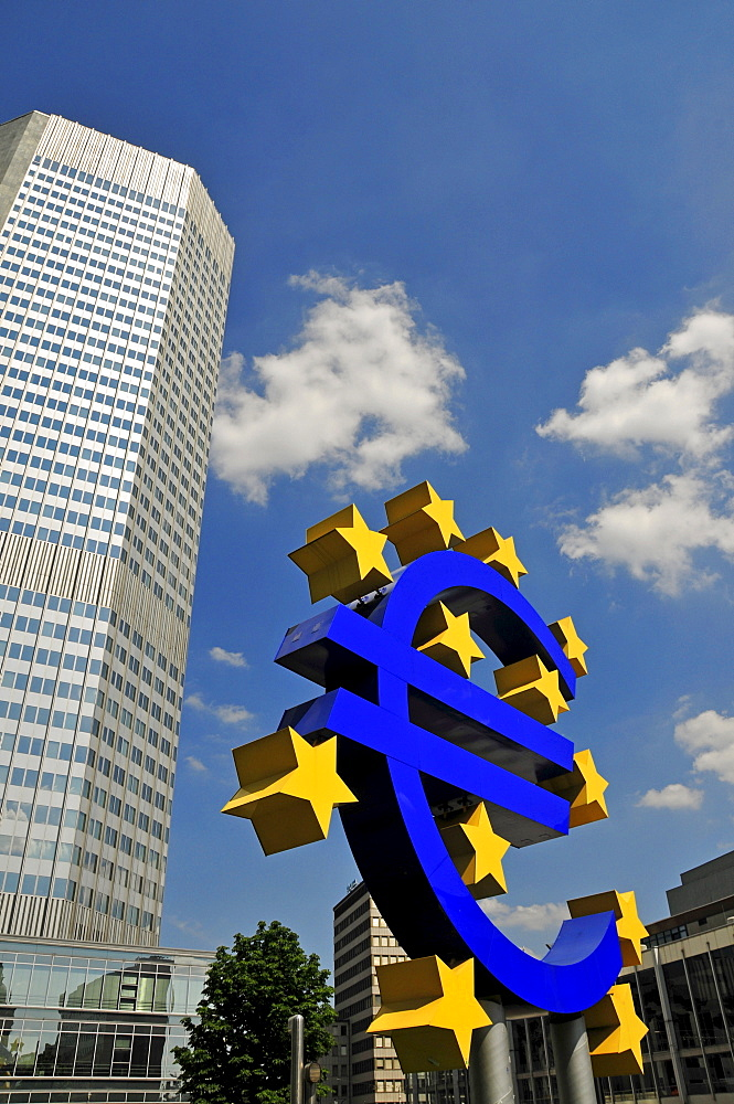 Euro symbol surrounded by stars, in front of a multistory building, Eurotower of the European Central Bank, Frankfurt, Hesse, Germany