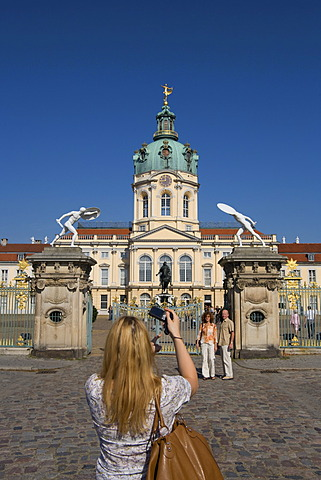 Tourist takes a picture of castle Charlottenburg, south portal, Charlottenburg-Wilmersdorf, Berlin, Germany