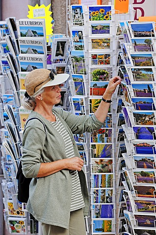 Woman looking at postcards outside a souvenir shop, Sault, Vaucluse, Provence-Alpes-Cote d'Azur, Southern France, France, Europe, PublicGround