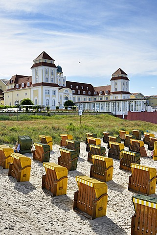 Roofed wicker beach chairs on the beach in front of the Kurhaus spa building, Binz, Mecklenburg-Western Pomerania, Germany