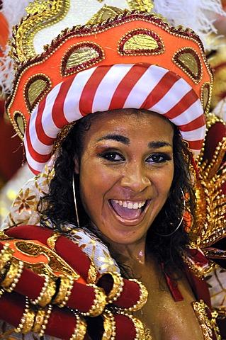 Unidos da Tijuca samba school, laughing young woman in costume, Carnaval 2010, Sambodromo, Rio de Janeiro, Brazil, South America