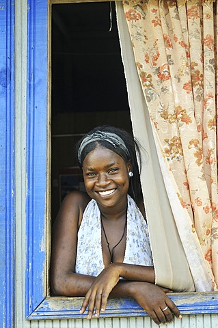 Young woman, Afro-Colombian, in the window of her house, Bajamar slum, Buenaventura, Valle del Cauca, Colombia, South America