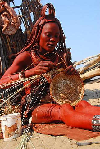 Himba woman making a bast mat, handicrafts, Purros, Kaokoveld, Namibia, Africa