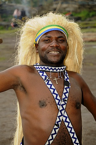 Traditional dancer during a folklore event in a village of former hunters near the village of Kinigi on the edge of the Volcanoes National Park, Parc National des Volcans, Rwanda, Africa