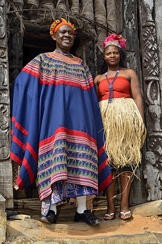 King Fon Abumbi II, head of one of the traditional kingdoms in north west Cameroon, in front of the Achum sanctuary at his seat of power with one of his favourite wives, Bafut Palace, near Bamenda, Cameroon, Central Africa, Africa