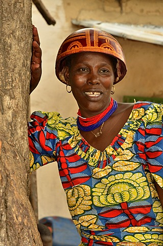 Woman wearing the calabash helmet that is typical for the region and a colourful dress, village of Tourou, Cameroon, Central Africa, Africa