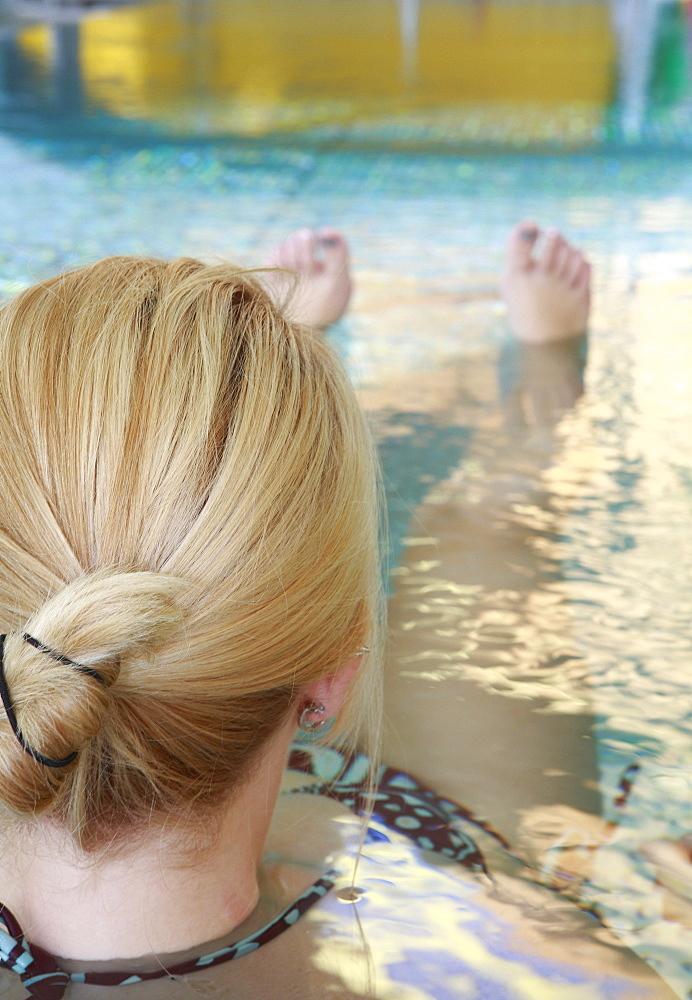 Woman in swimming bath