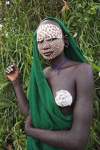 Young Surma woman with traditional body painting, Kibish, Omo valley, Ethiopia, Africa