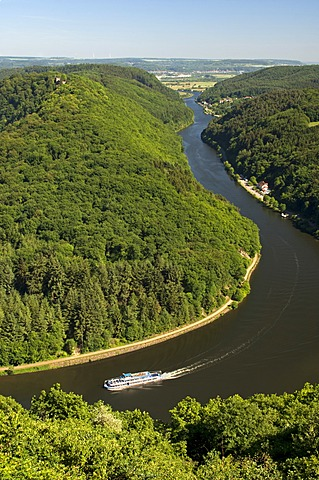 Excursion boat cruising on one arm of the big loop of the Saar river near Mettlach, Saarland, Germany, Europe