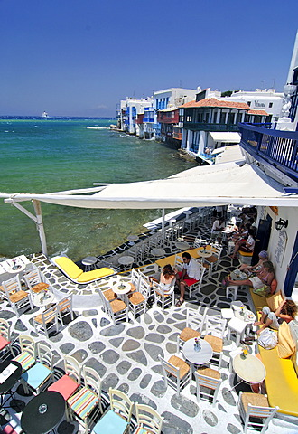 Bar located on the promenade along the port of Little Venice, tessellated stone floor, Mykonos Island, Cyclades, Greece, Europe