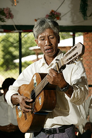 Indian playing guitar, Loma Plata, Chaco, Paraguay, South America