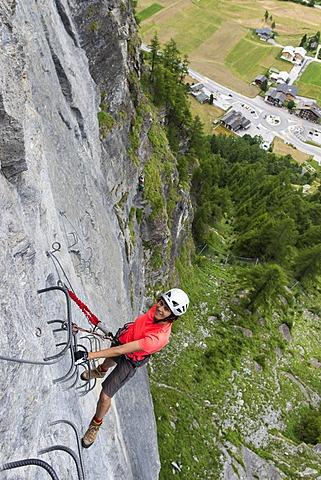 "Female climber on the fixed rope route ""Via ferrata d'Evolene Region"", Evolène, Canton of Valais, Switzerland"