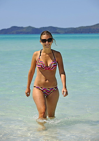 Young woman in the sea, Whitehaven Beach, Whitsunday Island, Whitsunday Islands National Park, Queensland, Australia