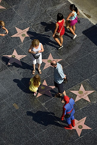 Tourists taking photographs in front of terrazzo star for Britney Spears, Walk of Fame, Hollywood Boulevard, Hollywood, Los Angeles, California, United States of America, USA, PublicGround