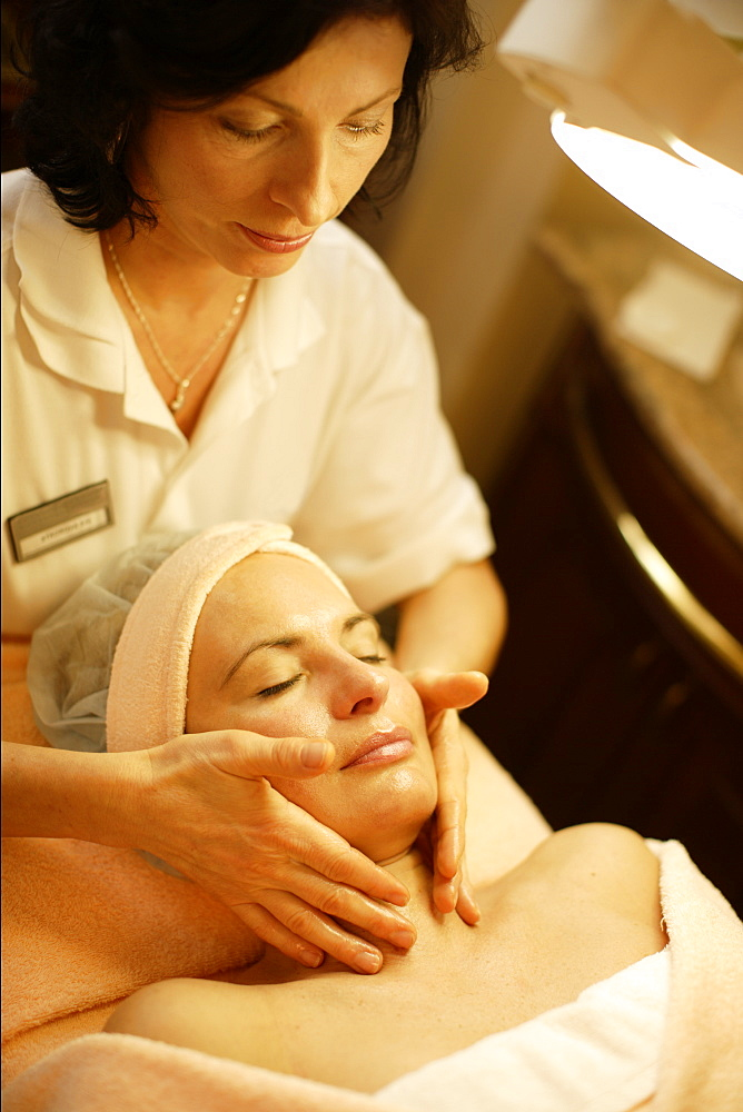 Woman having a face massage
