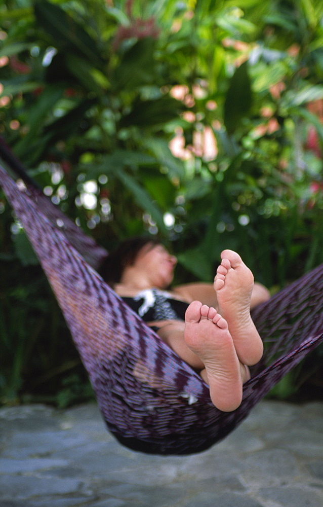 A woman is relaxing in a hammock, Costa Rica, Central America