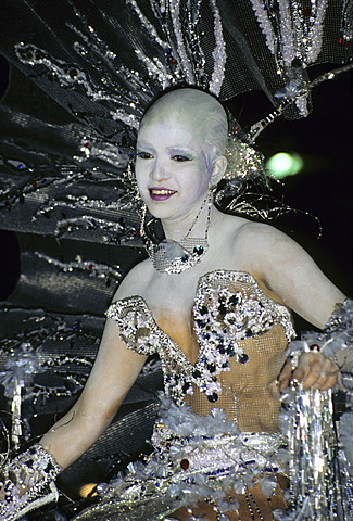 Costumed female dancer during Carnival in Santa Cruz on Tenerife Island, Canary Islands, Spain