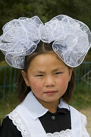 Portrait of a girl in traditional dress, Torugart, Kyrgyzstan, Central Asia