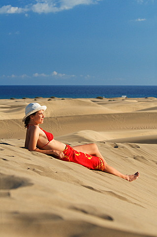 Woman in the sand dunes of Maspalomas, Gran Canaria, Canary Islands, Spain, Europe