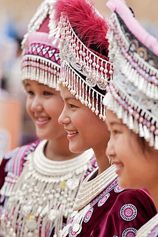 Young Hmong women, traditionally dressed, take part in a new year festival parade at Hung Saew village, Chiang Mai, Thailand, Asia