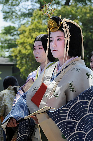 Court ladies of the royal household of the Saio dai, wearing the traditional headdress and kimono from the Heian Period, at the Kamigamo Shrine in Kyoto, Japan, Asia