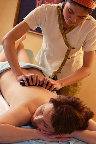 Woman, 35, having a hot stone massage