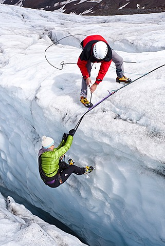 Mountaineers climbing on Zufallferner Glacier, during a crevasse rescue, South Tyrol, Italy