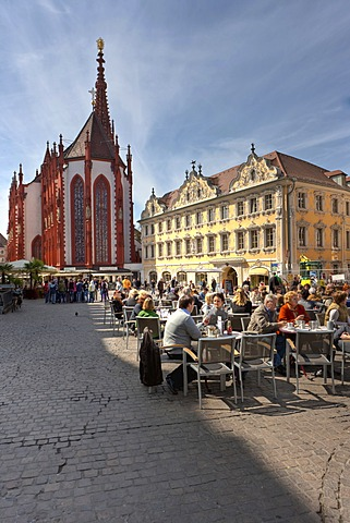 Tourists sitting at a sidewalk cafe in front of the Falkenhaus building and Our Lady's Chapel, Marktplatz square, Wuerzburg, Bavaria, Germany, Europe