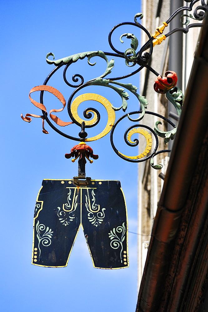 Hanging sign of a traditional costume shop, Residenzplatz square, Salzburg, Austria, Europe
