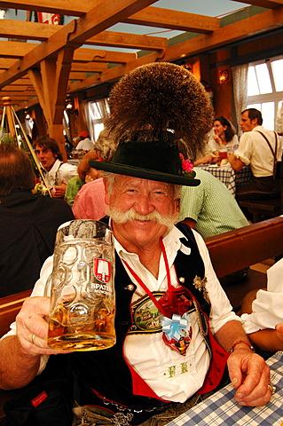Bavarian man in traditional costume, Wies\'n, October fest, Munich, Bavaria, Germany, Europe