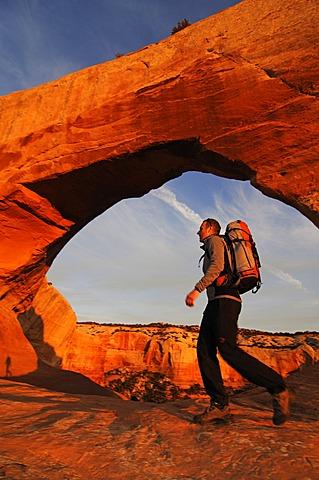 Hiker, Wilson Arch, Moab, Utah, USA
