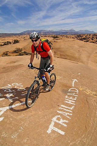 Mountain biker on Slickrock Trail, Moab, Utah, USA