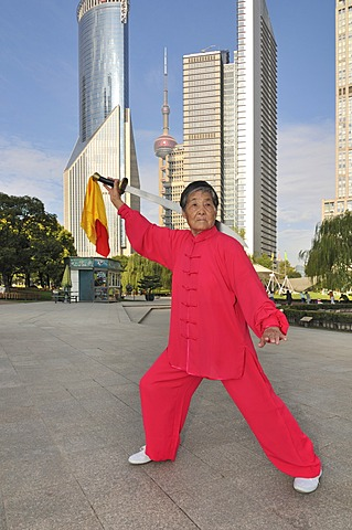 Old woman exercising, swordplay, Lujiazui Park, Oriental Pearl Tower, Pudong, Shanghai, China, Asia