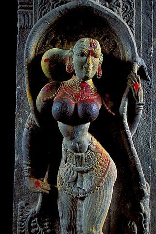 Sculpture of a woman decorated with kumkum powder, entrance of Minakshi, Meenakshi or Sri Meenakshi-Sundareshwara Temple, Madurai, Tamil Nadu, South India, India, Asia