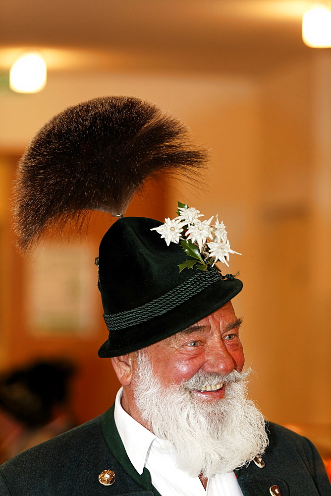 Man with white beard wearing a Gamsbart, traditional Bavarian dress hat, Upper Bavaria, Germany, Europe