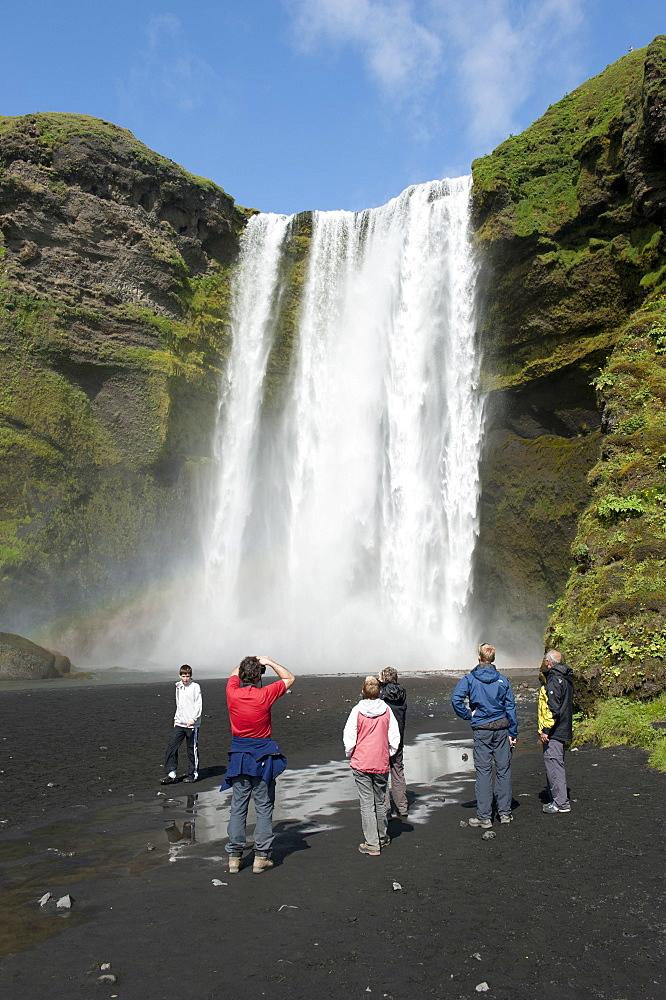 Large waterfall Skógafoss with tourists, Skogar, Iceland, Scandinavia, Northern Europe, Europe