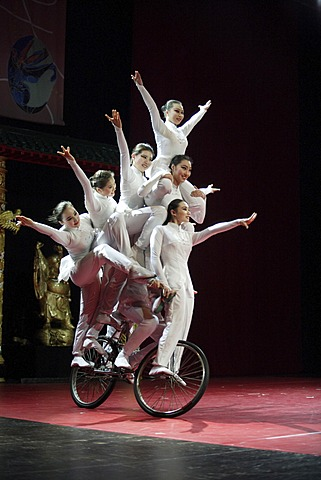 Chinese artists balance on a bicycle