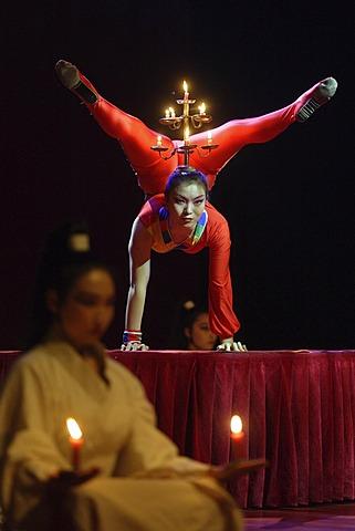 Chinese artists balance candleholder