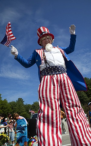 Uncle Sam on stilts at the July 4 parade in a small New England town, Amherst, New Hampshire, USA