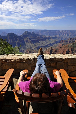 Holidaymaker enjoying the view from the terrace of the Grand Canyon Lodge towards Deva Temple, Brahma Temple, Grand Canyon National Park, North Rim, Arizona, United States of America, USA