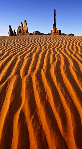 Sand dunes in front of Totem Pole and Yei Bi Chei rock formations after sunrise, Monument Valley, Navajo Tribal Park, Navajo Nation Reservation, Arizona, Utah, Southwest, United States of America, USA