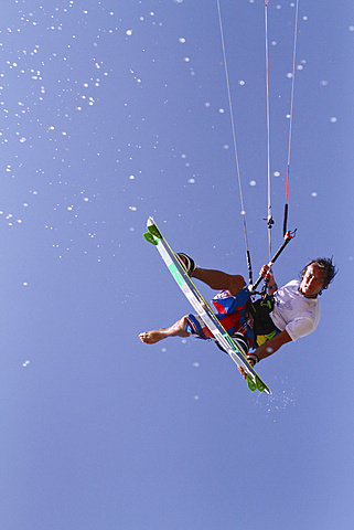 Kitesurfer jumping with splashing water, El Gouna, Red Sea Governorate, Egypt, Africa