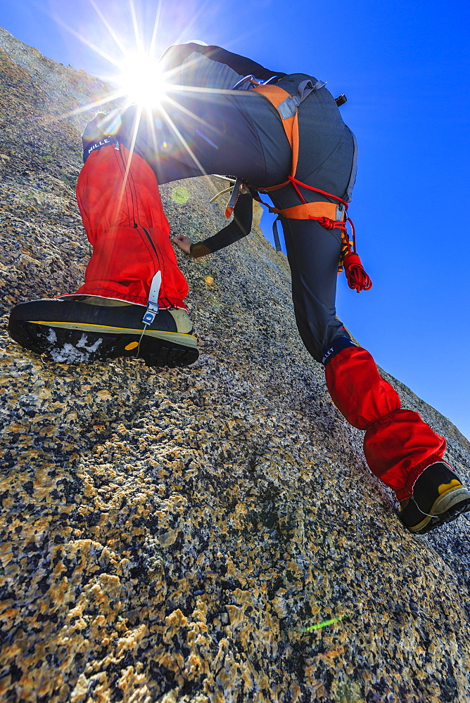 Climber climbing on a rock wall, alpine climb, Alps, below the summit, Petite Forch, Canton of Valais, Switzerland, Europe - 832-378430